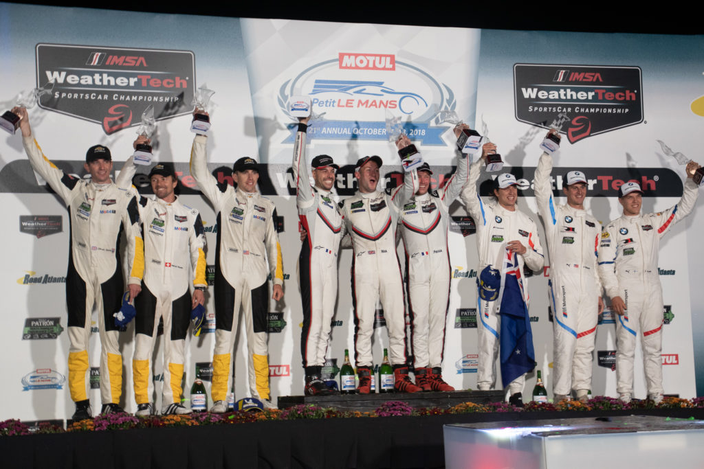 (Left to Right) Oliver Gavin,Marcel Fassler, Tommy Millner, Frédéric Makowiecki, Nick Tandy, Patrick Pillet, Chaz Mostert, Jon Edwards, Jesse Krohn Celebrate on the GT Le Mans Podium at Road Atlanta. Photo By Eric Cumbee
